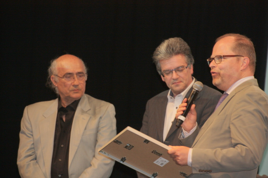 Von links: Vito Fiorino und Antonio Umberto Riccò mit Staatssekretär Christian Lange (BM Justiz)